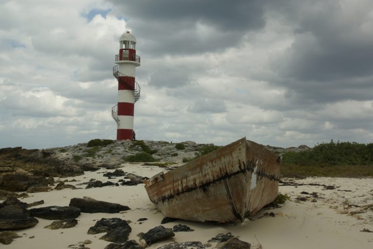 Boat in Front of Punta Cancun Lighthouse taken by CloseUp Images