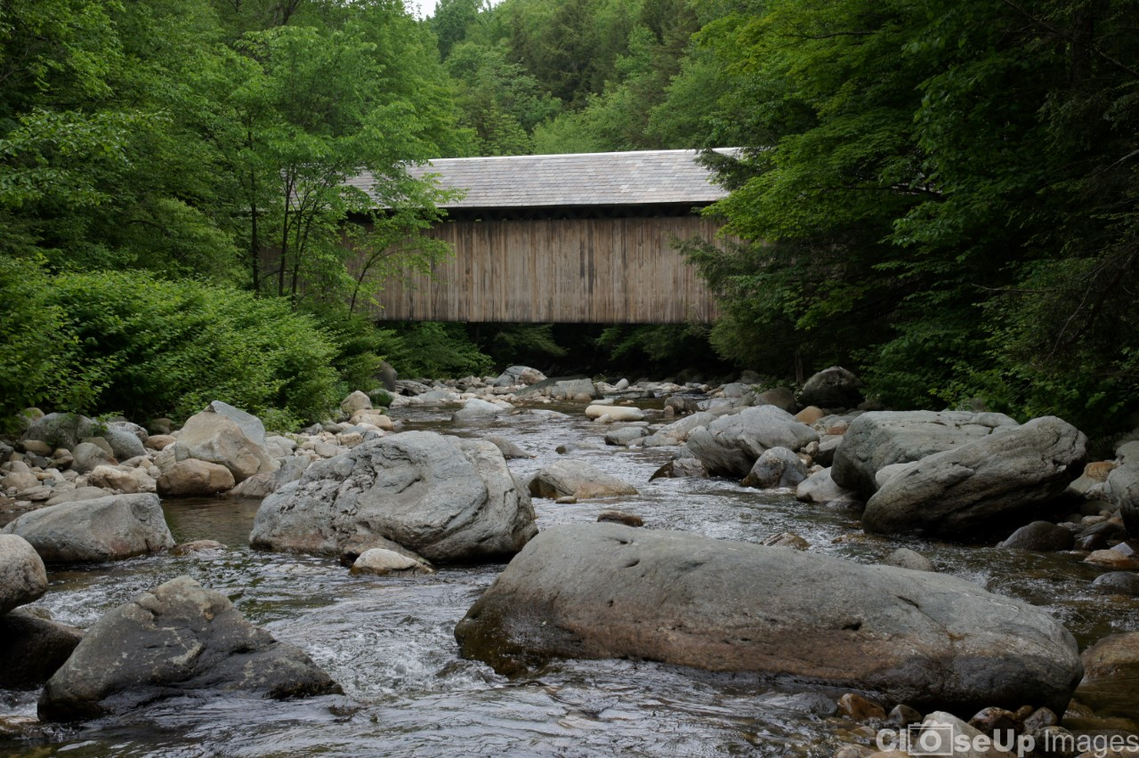 Brown Covered Bridge over Rocky Stream. Taken by CloseUp Images