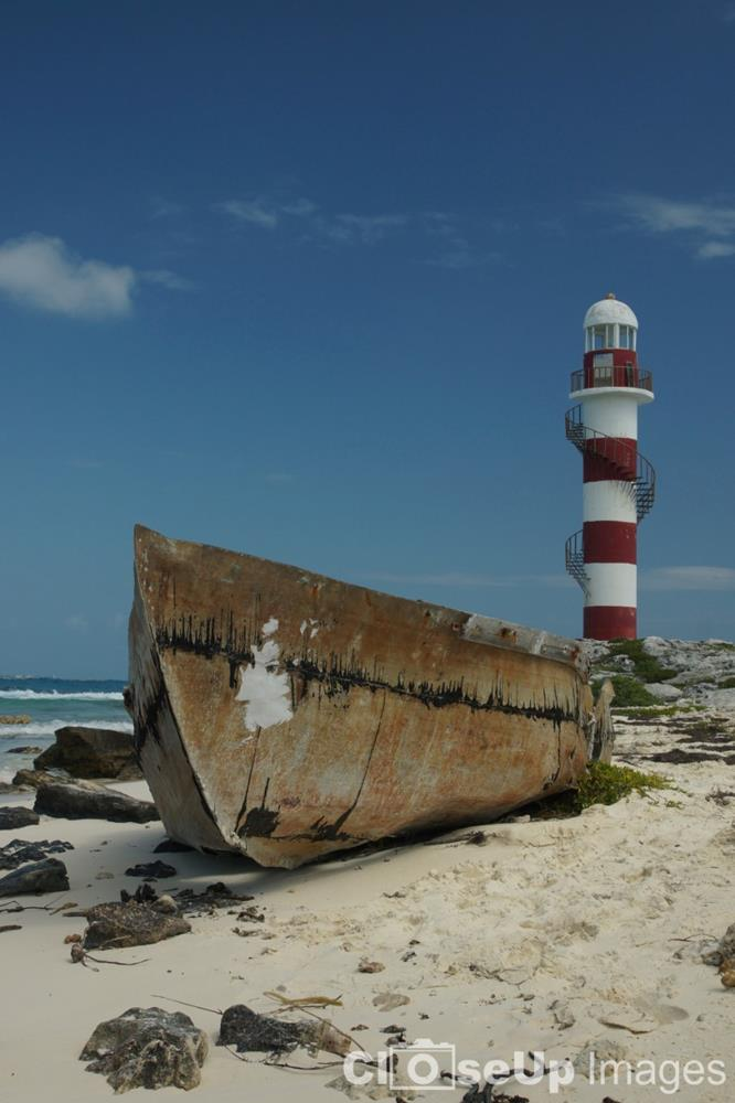 Cancun Lighthouse and Boat. Taken by CloseUp Images