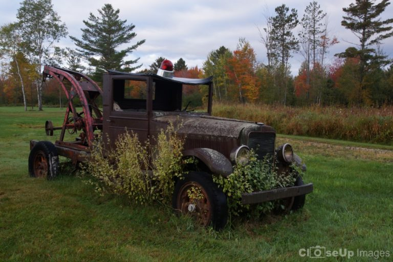 Rusty Tow Truck in Field. By CloseUp Images